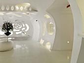 Futuristic, monochromatic white lobby with cutouts in wall