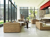Wicker furniture in large modern sunroom