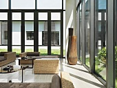 Wicker furniture in large modern sunroom