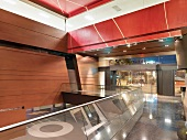 Lobby inside modern building with red ceiling