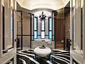 Elegant bathroom with zebra patterned marble floor