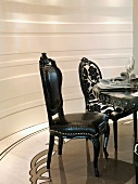 Elegant black chairs at dining table