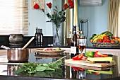 Still-life arrangement of vegetables, herbs and wine in kitchen (Villa Octavius, Lefkas, Greece)