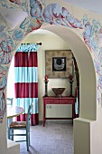 Open doorway to dining room with mural on wall (Villa Octavius, Lefkas, Greece)