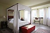 Romantic bedroom with four-poster bed (Villa Octavius, Lefkas, Greece)