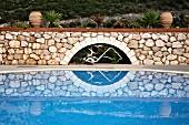 Stone wall behind swimming pool (Villa Octavius, Lefkas, Greece)