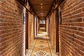 Hotel Hallway With Brick Walls