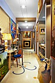 Gallery of modern object d'art, paintings and gilt furniture in hallway