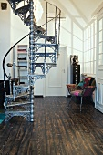Ornate, metal spiral staircase in interior