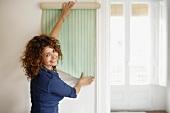 Woman trying wallpaper