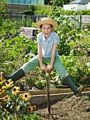 A young girl in a allotment garden