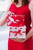 Young woman holding presents