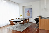 Dining Room off of Kitchen with Wooden Floors