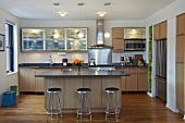 Contemporary Kitchen Interior with Stainless Steel Stools and Appliances