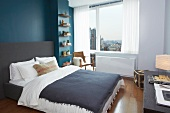 Bedroom with Blue Accent Wall; City Views