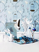 Playfuly decorated - a white rabbit and ladies shoe in front of floral and wallpaper with birds and flowers