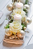 Advent arrangement of white candles and roses