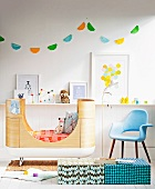Children's room with a functional bed, designer chair and homemade pennant made from doilies
