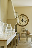 Oversized clock hangs near chimney breast of Provence country house kitchen