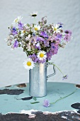 Bouquet made of daisies, purple bellflowers and wild flowers