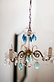 Detail of chandelier with assorted blue glass drops