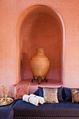 Large urn in the arched alcove of a salon marocain.