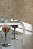 Curved kitchen counter and bar stools