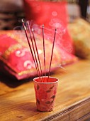 Joss sticks in paper beaker