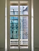 View through closed balcony doors of the modern house next door (Goethe Institut, London)