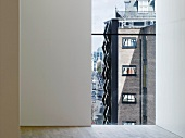 View through a floor to ceiling window of a contemporary apartment building (Photographers' Gallery, London)