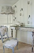 Mirrored console table and renovated antique chair on gallery