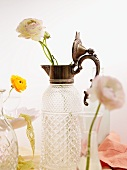 Elegant crystal carafe with silver fittings used as vase