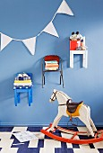 Children's chairs hung on wall and used as shelves