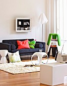 Cheerful living room with colourful stacking stools and side table elements in white plastic