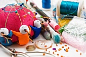 Pin cushions, scissors, buttons and craft supplies