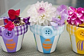 Flowers in plant pots decorated with buttons