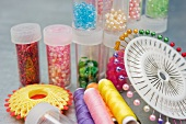 Sewing pins, thread and decorative beads