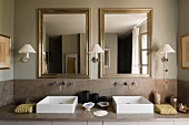 Modern twin square basins and mirrors in bathroom in grey tones