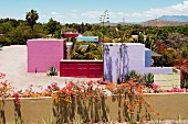 Courtyard of Hotelito with four brightly coloured guest buildings; Rosa, Azul, Verde and Violette