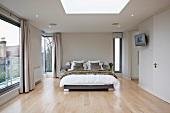 Elegant designer style bedroom with floor to ceiling windows
