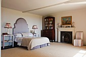 Bedroom in home of fabric designer Richard Smith in East Sussex with 18th century Capriccio