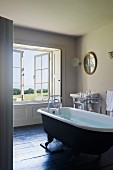 Free standing rolltop bath in home of fabric designer Richard Smith in East Sussex