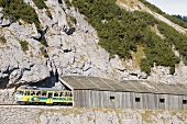 Wendelstein rack railway in front of a mountain face (Germany)