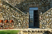 Stone house with entrance flanked by staircases