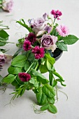 Table decoration made of roses, corn flower and vetches