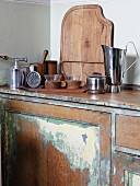 High-quality kitchen utensils on vintage kitchen counter with dilapidated base unit