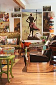 Colourful, eclectic mixture of furniture and paintings