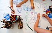 Children drawing on table