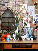 Spring atmosphere - bird and rabbit motifs on vintage console table and on brick wall
