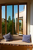 Loggia with scatter cushions on upholstered bench